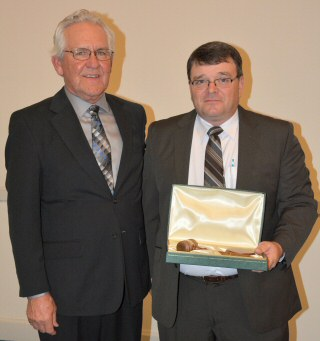 IASM President Jim Herman, left, passes the gavel to incoming President Don Toothman, Jr.